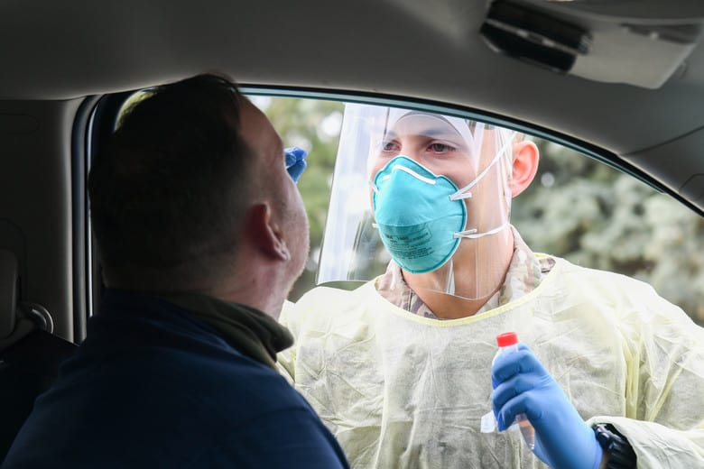 Staff Sgt. Pablo Durand, 75th Medical Group, swabs Chief Master Sgt. Eric Engel, 421st Fighter Squadron, for COVID-19 during a medical screening May 15, 2020 at Hill Air Force Base, Utah. (U.S. Air Force photo by Cynthia Griggs)